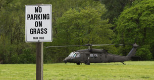 No Parking On Grass Helicopter. Some natural and manmade disasters require rescue services. This is a Blackhawk helicopter being used in a mock disaster relief Stock Photos