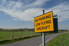 No parking low flying aircraft sign. Stock Photo
