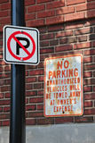 No Parking new and old. Old sign and new sign of a no parking zone Stock Photography