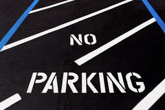 No Parking Painted on  Diagonal Parking Lot Royalty Free Stock Image