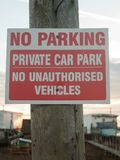 No parking private car park no authorized vehicles sign on post Royalty Free Stock Images