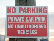 No parking private car park no authorized vehicles sign on post Stock Images