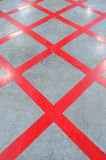 No parking red cross zone, criss-cross painted on polished floor Royalty Free Stock Image