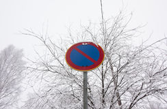 No parking road sign on winter sky background. Royalty Free Stock Photo