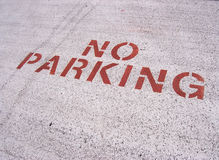 No Parking Sign. Sign painted on area of parking lot Royalty Free Stock Images