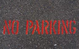 No Parking. Sign on asphalt street pavement Stock Photos