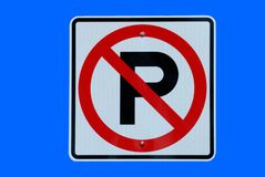 No parking sign. On a blue background Royalty Free Stock Image