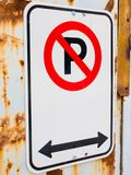 No Parking Sign Bolted to an industrial rusty building wall. No Parking Sign Bolted to an industrial  building wall Royalty Free Stock Photos