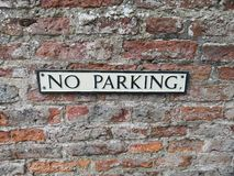 No parking sign on a brick wall background. York, England UK stock images