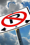 No Parking Sign Dramatic. A dynamic composition of a no parking sign against a vivid sky Stock Image