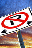 No Parking Sign Dramatic. A dynamic composition of a no parking sign against a vivid sky Stock Photography
