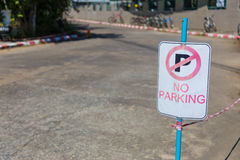 No parking sign on an empty street Royalty Free Stock Photos