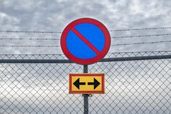 No parking sign on a fence royalty free stock image