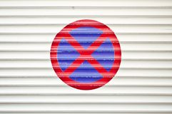 No Parking sign on garage door royalty free stock images