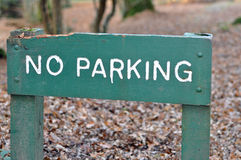 No Parking sign. A green wooden no parking sign in a forest Stock Image