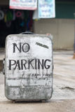 No parking sign on an old suitcase. stock photos