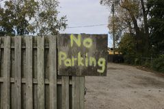 No parking sign on a hand made sign royalty free stock photos