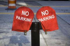 No Parking Sign on red material Stock Photography