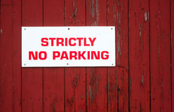 no parking sign on red wood background Royalty Free Stock Images