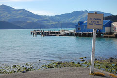 No parking sign sea coast Akaroa bay Royalty Free Stock Photography