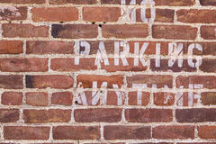 No parking sign on solid wall Royalty Free Stock Image