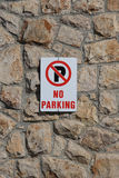 No Parking Sign on Stone Wall Stock Photos