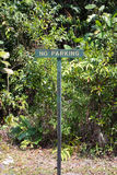 No Parking. A No Parking sign in a tropical forest in Sarawak province, Borneo, Malaysia Stock Photo