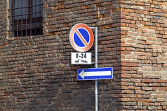 No Parking sign on a vignetted old brick wall. Stock Photos