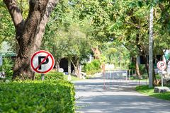 Free No Parking Sign With National Park In Background. Royalty Free Stock Photos - 117555828