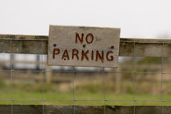 No Parking sign on wooden fence Royalty Free Stock Images