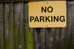 No Parking sign on wooden fence Stock Photography