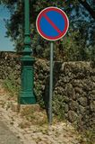 NO PARKING traffic sign post at the access road of Monsanto. NO PARKING traffic sign post in a sunny day, on cobblestone sidewalk at the access road of Monsanto royalty free stock photography
