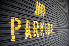 No parking - yellow sign on the garage Royalty Free Stock Photos