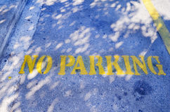 No parking yellow sign on the parking lot. stock photography
