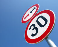No-passing and the speed limit. And sky Stock Photos