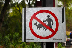 No pets signal. One metallic plate that shows no allowed pets, pets forbidden silver metallic plate in a park Royalty Free Stock Photo