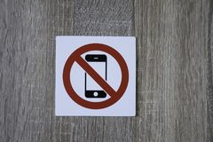 No phone allowed sign on the wooden wall Royalty Free Stock Photo