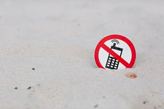 No phone calls sign on the beach. On sand background stock image