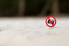 No photo sign on the beach. On sand background Royalty Free Stock Image