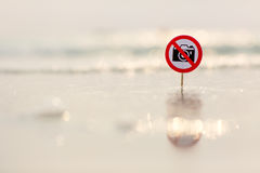 No photo sign on the beach. On sea background royalty free stock photo