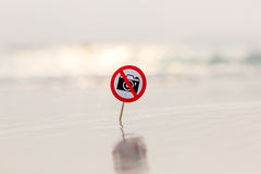 No photo sign on the beach. On sea background Royalty Free Stock Photography