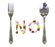 No pills or drugs between fork and spoon Royalty Free Stock Images