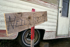 No Place Like Home. A closeup on a sign outside of an old beatup trailer stock photo