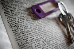 No Place Like Home. A set of keys pictured with the definition of home in a dictionary royalty free stock photo