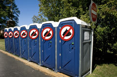 No Poop Outhouse. Outhouses in a row with no poop royalty free stock image