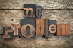No problem, phrase written with vintage letterpress printing blo. Phrase `no problem` written with vintage letterpress printing blocks on rustic wood background Stock Images