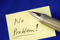 No Problem on a yellow sticker. Isolated on blue Royalty Free Stock Images