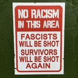 No Racism in this Area Sign. Sign reads:No Racism in this Area.Racism is the belief in the superiority of one race over another which results in discrimination stock photos