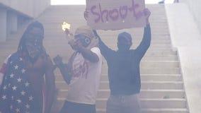 No racism. Black man raised sign dont shoot. Black Lives Matter. Justice in USA.