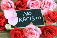 No racism. Message against racism on blackboard Stock Photos